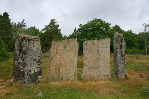 Four large, standing stone slabs